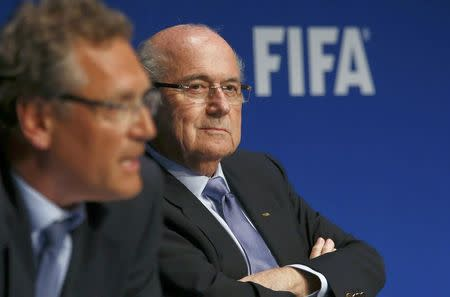FIFA President Blatter listens to secretary general Valcke during news conference in Zurich
