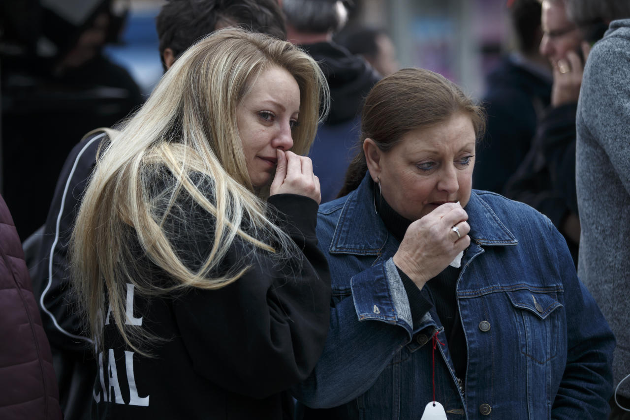<p>January Wood (L) and her mother Susan Wood react as they take in the memorial for victims of the mass killing on Yonge Street in Toronto. Cole Burston/Getty Images </p>