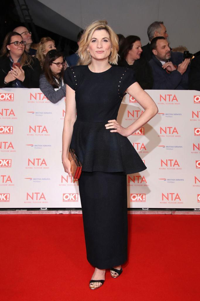 <p>Jodie Whittaker brought the peplum back at tonight's awards show in a black, ankle-skimming dress. <em>[Photo: Getty]</em> </p>