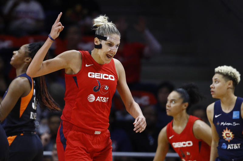 Washington Mystics forward Elena Delle Donne reacts after being fouled while scoring in the first half of Game 1 of basketball's WNBA Finals against the Connecticut Sun, Sunday, Sept. 29, 2019, in Washington. (AP Photo/Patrick Semansky)