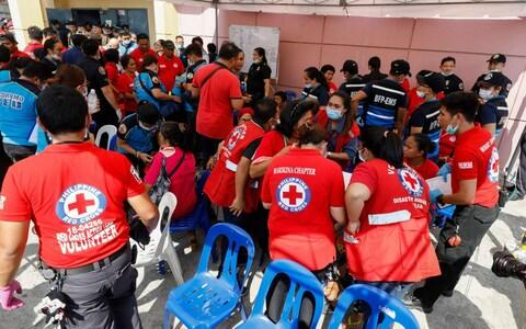 Emergency responders attend to Filipino supporters of former Philippine first lady Imelda Marcos - Credit: ROLEX DELA PENA/EPA-EFE/REX