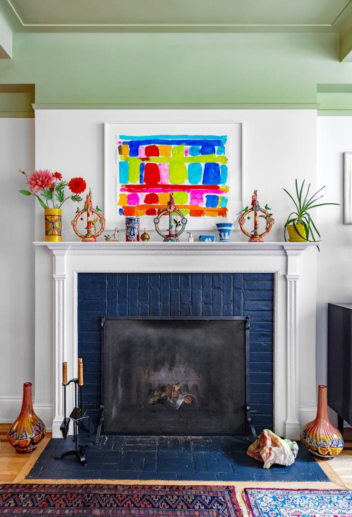 "<div class=""caption""> For the most part, Joey will arrange a piece to ""fit"" within a certain color scheme or set of proportions he has in his mind. Once it's there, it usually stays. The fireplace <a href=""https://www.architecturaldigest.com/story/4-ways-to-dress-your-mantel?mbid=synd_yahoo_rss"" rel=""nofollow noopener"" target=""_blank"" data-ylk=""slk:mantel"" class=""link rapid-noclick-resp"">mantel</a> is one place that's open to reinterpretation. </div>"