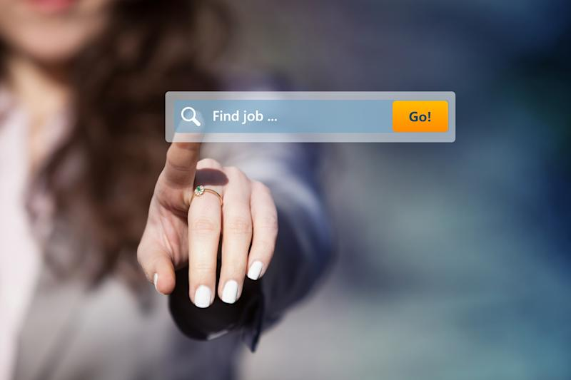 Find job typed in a search box with a woman touching it.