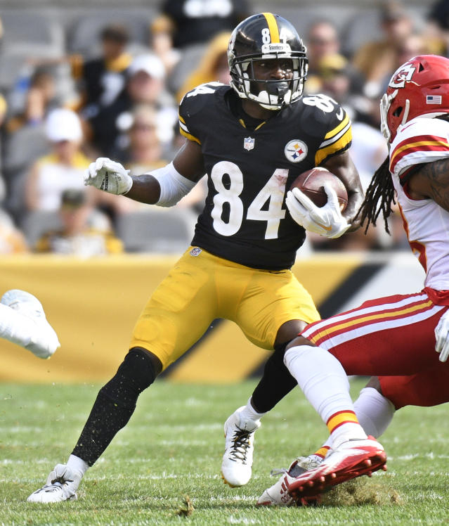 In this Sunday, Sept. 16, 2018 photo, Pittsburgh Steelers wide receiver Antonio Brown (84) runs with the ball as Kansas City Chiefs linebacker Terrance Smith (48) defends in an NFL football game in Pittsburgh. The Steelers began the season saying they needed to avoid the drama that plagued them in 2017. And yet two weeks in the team is winless, Antonio Brown is frustrated and Le'Veon Bell is MIA. (AP Photo/Don Wright)