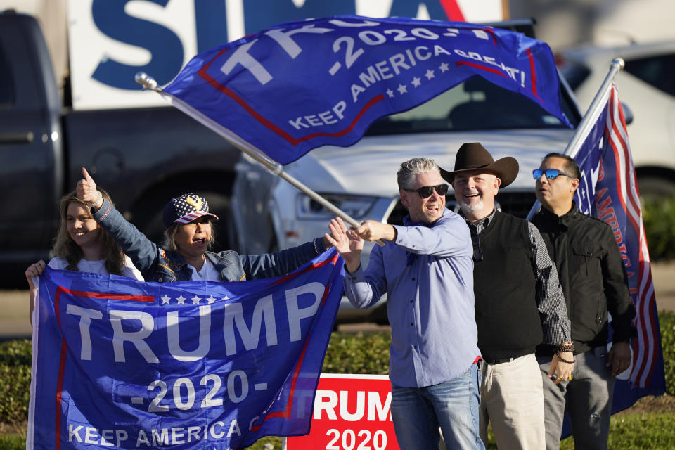 Supporters of President Trump cheer as passing cars honk their horns near a polling location on Election Day, Tuesday, Nov. 3, 2020, in Houston. (AP Photo/David J. Phillip)