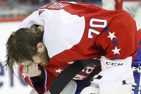 Jan 12, 2019; Washington, DC, USA; Washington Capitals goaltender Braden Holtby (70) holds his eye after being injured against the Columbus Blue Jackets in the second period at Capital One Arena. Mandatory Credit: Geoff Burke-USA TODAY Sports
