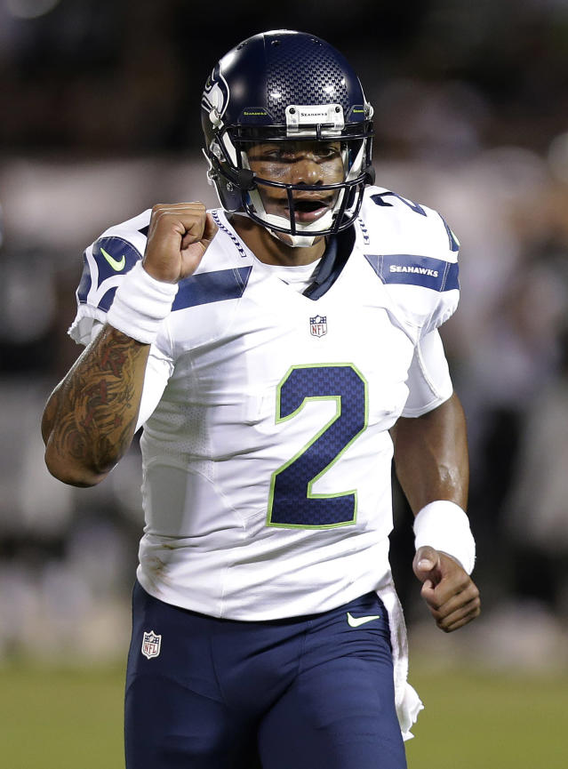 Seattle Seahawks quarterback Terrelle Pryor celebrates after throwing a 33-yard touchdown pass to wide receiver Phil Bates during the second quarter of an NFL preseason football game against the Oakland Raiders in Oakland, Calif., Thursday, Aug. 28, 2014. (AP Photo/Marcio Jose Sanchez)