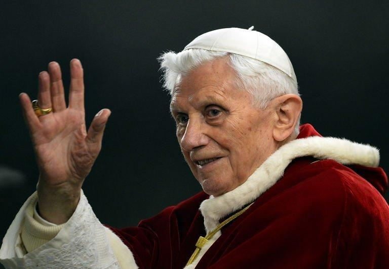 Pope Benedict XVI waves to worshippers as he arrives at St. Peter's Square on December 29, 2012