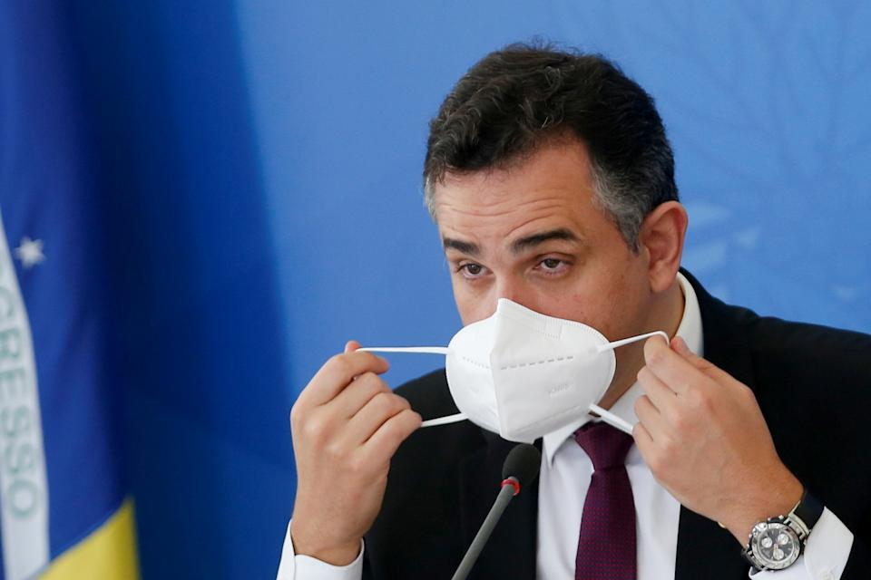 President of Brazil's Senate Rodrigo Pacheco adjusts his protective face mask during a news conference after the meeting of the National COVID-19 Coordinator to combat the pandemics, in Brasilia, Brazil, April 14, 2021. REUTERS/Adriano Machado