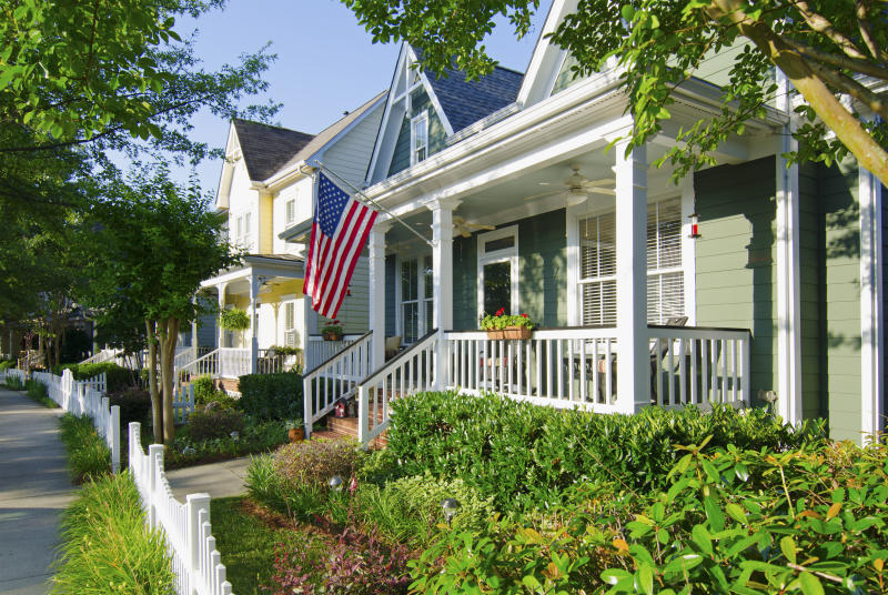 The American Dream of a house in a nice neighborhood with a white picket fence.