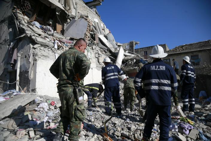 Rescuers search at a damaged building after a magnitude 6.4 earthquake in Thumane, western Albania, Tuesday, Nov. 26, 2019. (Photo: Visar Kryeziu/AP)