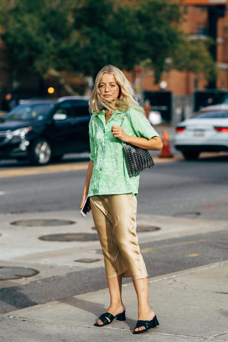 <p>A short-sleeved button-down is an unexpectedly awesome add-on to a slip skirt.</p>