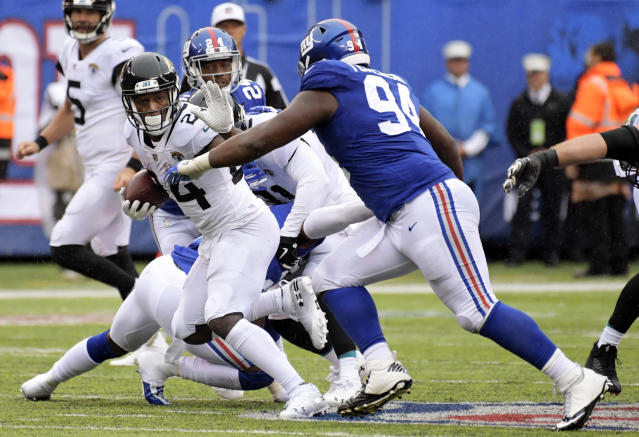 New York Giants' Dalvin Tomlinson (94) closes in on Jacksonville Jaguars' T.J. Yeldon (24) during the second half of an NFL football game Sunday, Sept. 9, 2018, in East Rutherford, N.J. (AP Photo/Bill Kostroun)