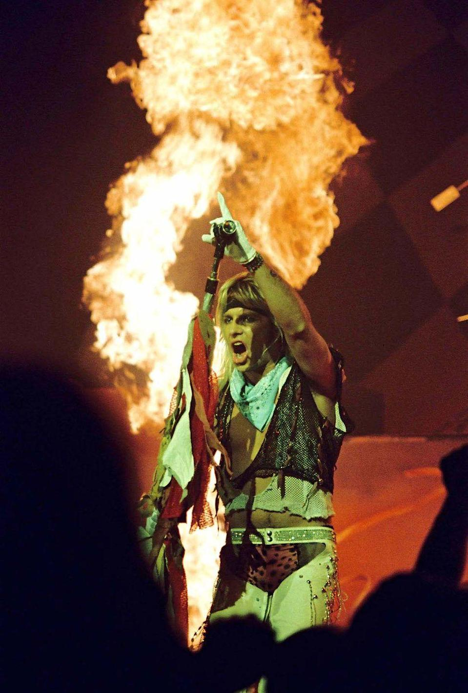 <p>Neil performing with a plume of fire behind him (a popular stage component for them) at the Hammersmith Odeon in London in 1986. </p>