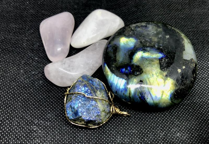 Clockwise from right: labradorite, lapis lazuli, rose quartz