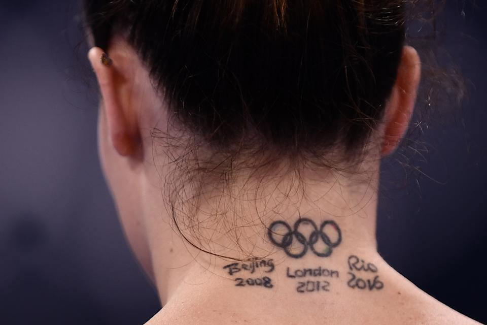 <p>Italy's Vanessa Ferrari gets ready to compete in the uneven bars event of the artistic gymnastics women's qualification during the Tokyo 2020 Olympic Games at the Ariake Gymnastics Centre in Tokyo on July 25, 2021. (Photo by Loic VENANCE / AFP)</p>