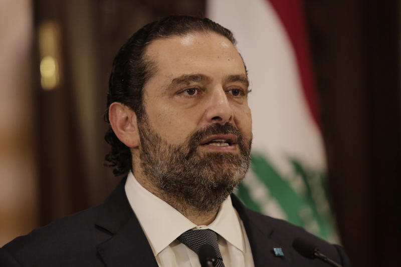 Lebanese Prime Minister Saad Hariri speaks during an address to the nation, in Beirut, Lebanon, Friday, Oct. 18, 2019. Hariri has given his political adversaries a 72-hour ultimatum to back his reform agenda amid growing nationwide protests over country's worsening economic crisis. (AP Photo/Hassan Ammar)