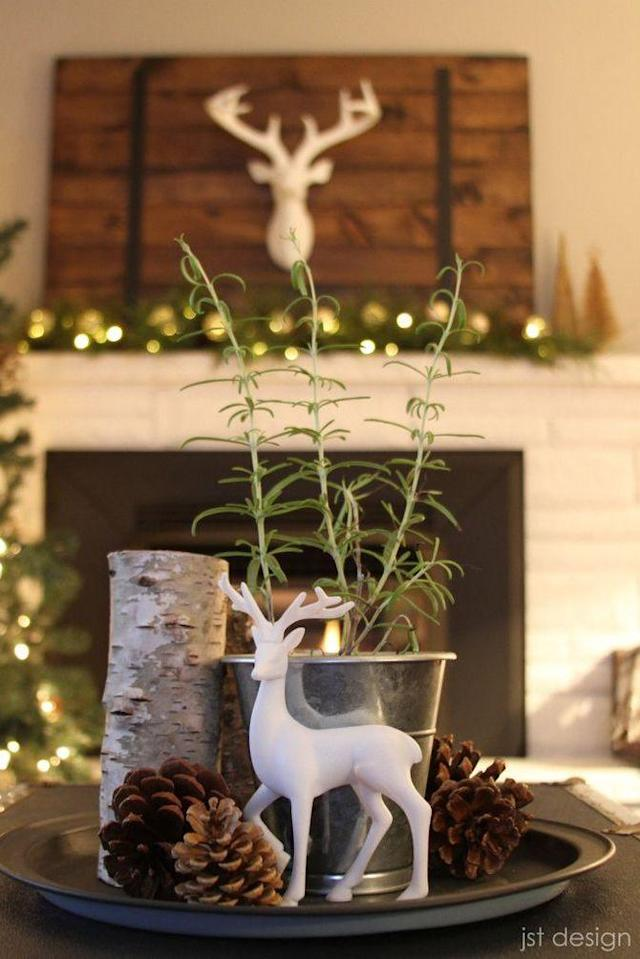 """<p>A small white deer stands out beside rosemary, pinecones, and birch bark candles. </p><p><strong>Get the tutorial at <a href=""""http://www.jstdesign.ca/our-christmas-home-tour/"""" rel=""""nofollow noopener"""" target=""""_blank"""" data-ylk=""""slk:JST Design"""" class=""""link rapid-noclick-resp"""">JST Design</a>.</strong></p><p><strong><a href=""""https://www.amazon.com/L-M-Z-Prancing-Figurine/dp/B01LDY2HN4/"""" rel=""""nofollow noopener"""" target=""""_blank"""" data-ylk=""""slk:SHOP DEER FIGURINE"""" class=""""link rapid-noclick-resp"""">SHOP DEER FIGURINE</a></strong></p>"""
