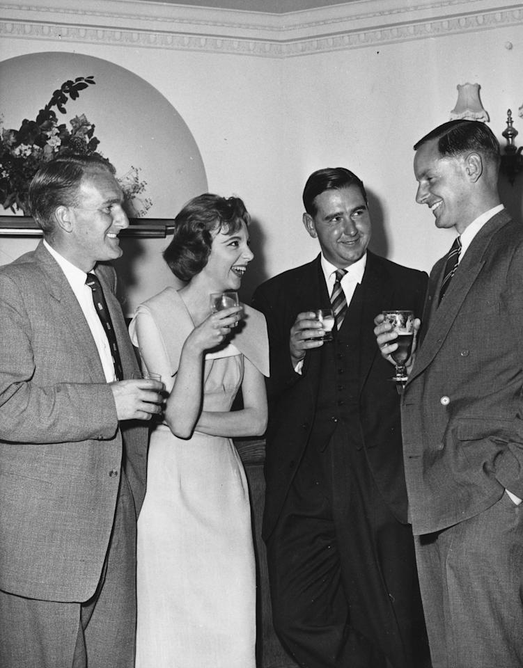 1957:  Actress Anna Massey at Westminster Theatre with cricketers Johnny Wardle (left), Colin Cowdrey  (1932 - 2000) and Peter May (right).  (Photo by Evening Standard/Getty Images)