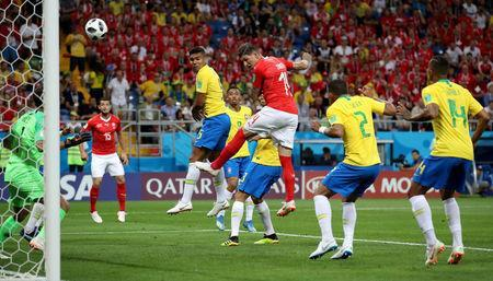 Switzerland's Steven Zuber scores their first goal. REUTERS/Marko Djurica