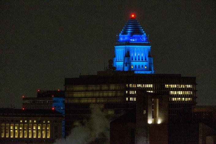 Los Angeles City Hall building is illuminated blue in downtown Los Angeles on April 9, 2020.