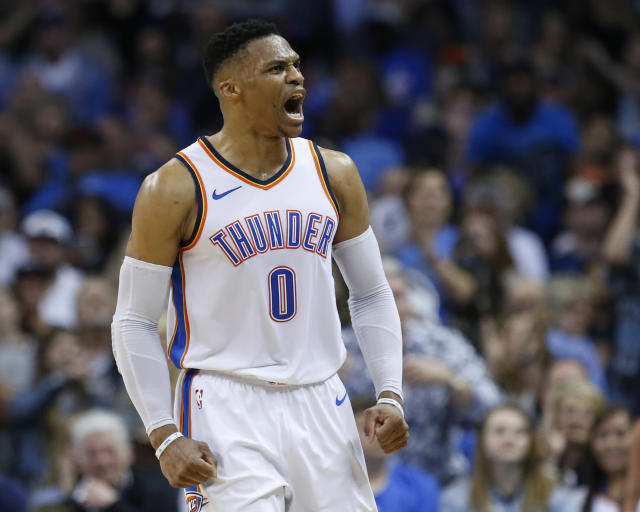 Oklahoma City Thunder guard Russell Westbrook shouts to the crowd in the first half of an NBA basketball game against the Denver Nuggets in Oklahoma City, Friday, March 30, 2018. (AP Photo/Sue Ogrocki)