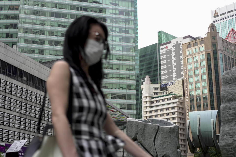 SINGAPORE, SINGAPORE - FEBRUARY 28: A lady wearing a mask walks past buildings at the Central Business District on February 28, 2020 in Singapore. The coronavirus, originating in Wuhan, China has spread to over 80,000 people globally, more than 50 countries have now been infected.  (Photo by Ore Huiying/Getty Images)