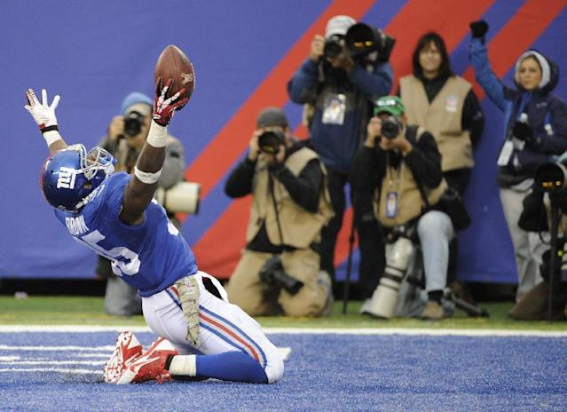 New York Giants running back Andre Brown celebrates after scoring a touchdown against the Oakland Raiders during the second half of an NFL football game, Sunday, Nov. 10, 2013, in East Rutherford, N.J. (AP Photo/Bill Kostroun)