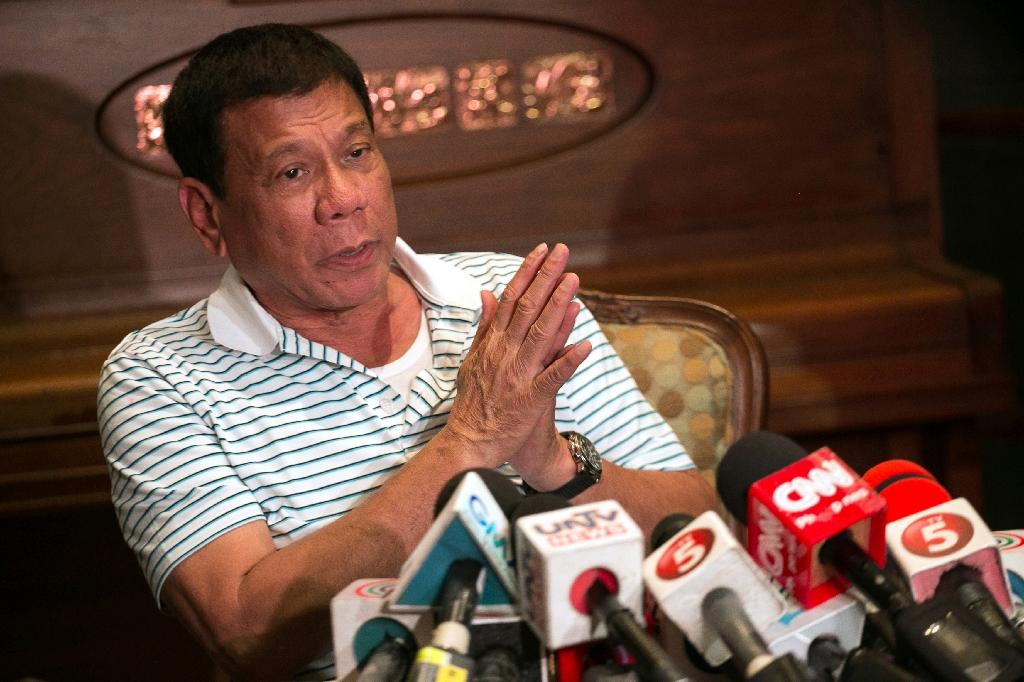 "Philippines' president-elect Rodrigo Duterte last year called Pope Francis a ""son of a whore"" for causing traffic jams when he visited Manila (AFP Photo/Manman Dejeto)"
