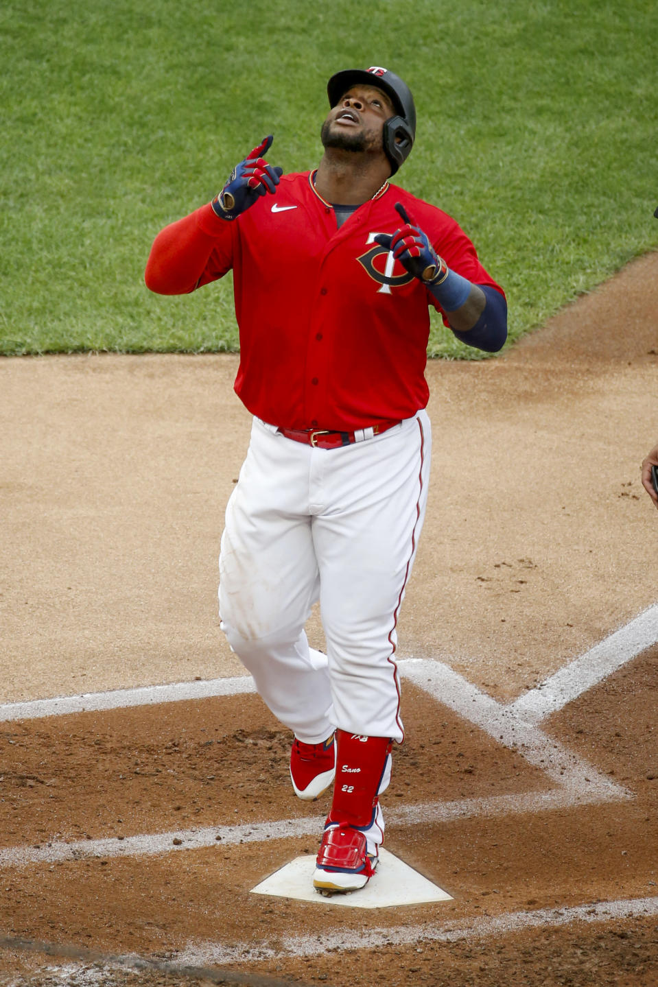 Minnesota Twins' Miguel Sano celebrates his solo home run against the Cleveland Indians in the third inning of a baseball game Saturday, Aug. 1, 2020, in Minneapolis. (AP Photo/Bruce Kluckhohn)