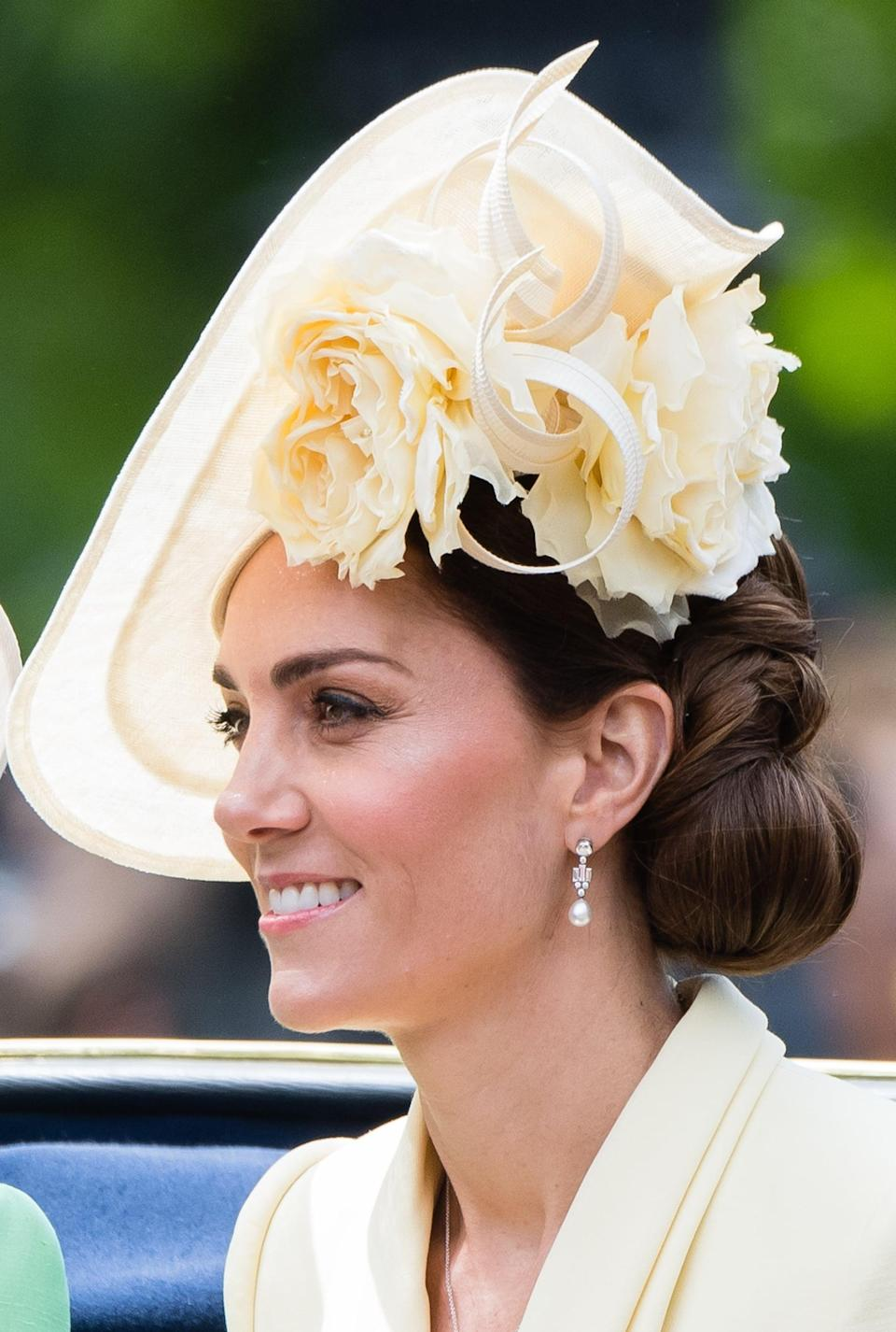 "<p>Here's another example - at this year's <a href=""https://www.popsugar.co.uk/beauty/Meghan-Markle-Kate-Middleton-Hair-Trooping-Colour-46247518"" class=""link rapid-noclick-resp"" rel=""nofollow noopener"" target=""_blank"" data-ylk=""slk:Trooping the Colour"">Trooping the Colour</a> - of a seemingly simple updo that upon closer inspection is actually incredibly intricate. We love how not only does the shape of her hair mimics the shape of the flowers of her Philip Treacy hat, but it also balances out the fact that the head-topper sits on such a sharp angle. </p>"