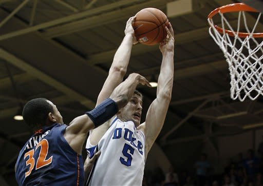 Duke's Mason Plumlee (5) goes up to the basket against Virginia's Darion Atkins (32) during the first half of an NCAA college basketball game in Durham, N.C., Thursday, Jan. 12, 2012. (AP Photo/Gerry Broome)
