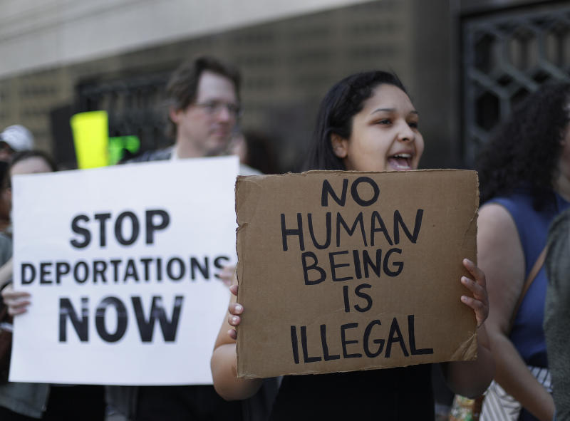 FILE - In this Tuesday, May 16, 2017, file photo, protesters rally outside a federal courthouse in Detroit. Protesters rallied in hopes public outcry will again delay the deportation of Jose Luis Sanchez-Ronquillo from the United States to Mexico. U.S. immigration arrests increased nearly 40 percent in early 2017 as newly emboldened agents under President Donald Trump detained more than 40,000 people suspected of being in the country illegally, with a renewed focus on immigrants without criminal convictions. (AP Photo/Paul Sancya, File)