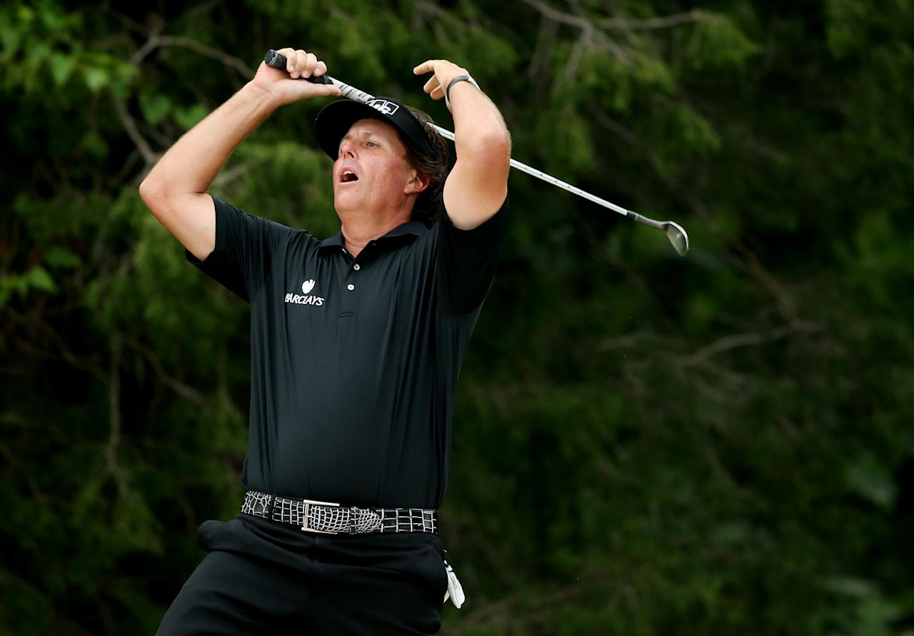 ARDMORE, PA - JUNE 16:  Phil Mickelson of the United States reacts after chipping to the second green during the final round of the 113th U.S. Open at Merion Golf Club on June 16, 2013 in Ardmore, Pennsylvania.  (Photo by Andrew Redington/Getty Images)