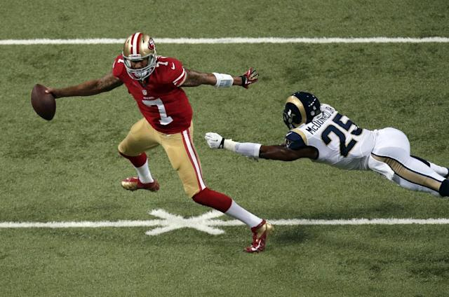 St. Louis Rams safety T.J. McDonald, right, cannot reach San Francisco 49ers quarterback Colin Kaepernick during the third quarter of an NFL football game Thursday, Sept. 26, 2013, in St. Louis. (AP Photo/Charlie Riedel)