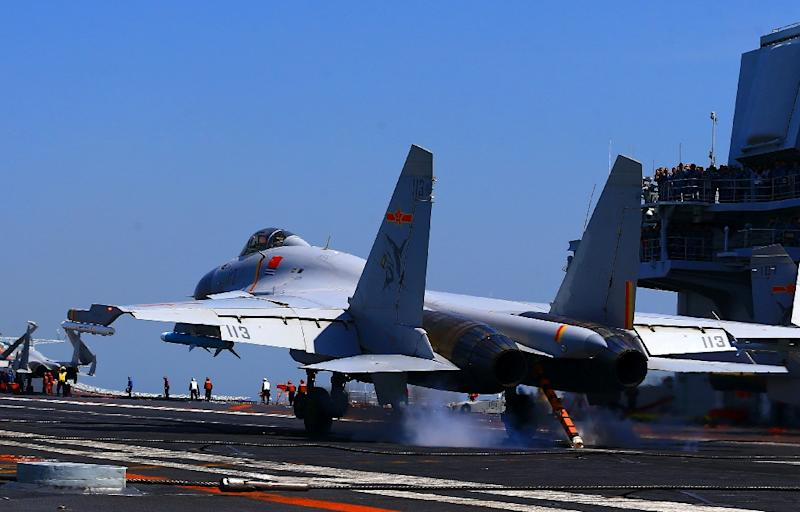 A J15 fighter jet landing on China's sole operational aircraft carrier, the Liaoning, during a drill