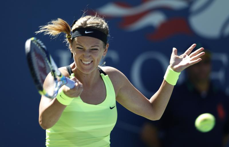 Victoria Azarenka of Belarus returns a shot against Kirsten Flipkens of Belgium in the second round of play at the 2012 US Open tennis tournament, Wednesday, Aug. 29, 2012, in New York. (AP Photo/Mel C. Evans)