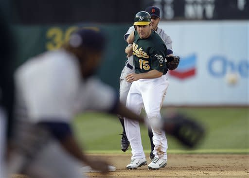Oakland Athletics' Seth Smith (15) collides with Detroit Tigers second baseman Danny Worth as Tigers' first baseman Prince Fielder, left, waits for the throw in a sixth inning double play during a baseball game Saturday, May 12, 2012, in Oakland, Calif. (AP Photo/Ben Margot)