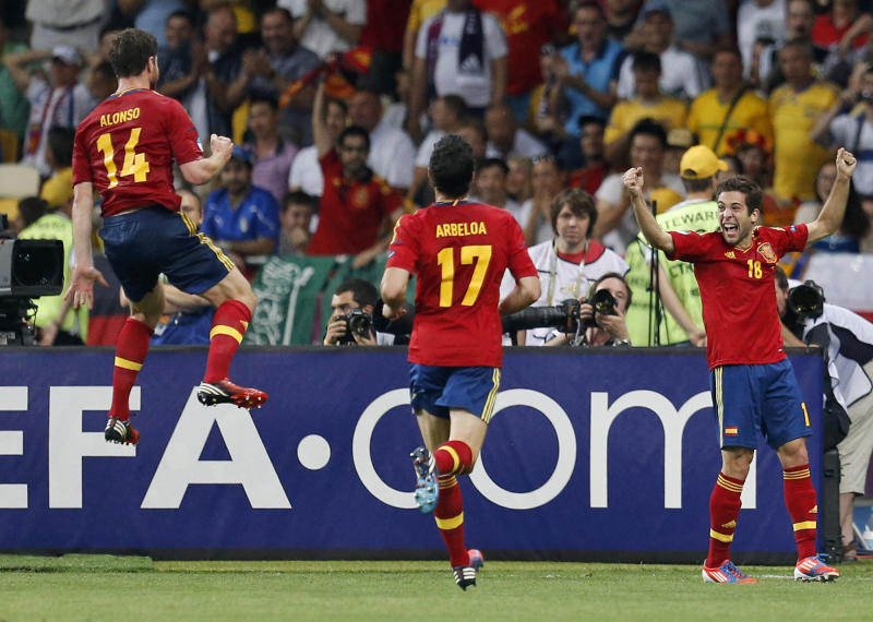 Spain's Jordi Alba celebrates their second goal with teammates during the Euro 2012 soccer championship final against Italy in Kiev, Ukraine, Sunday, July 1, 2012. (AP Photo/Matthias Schrader)