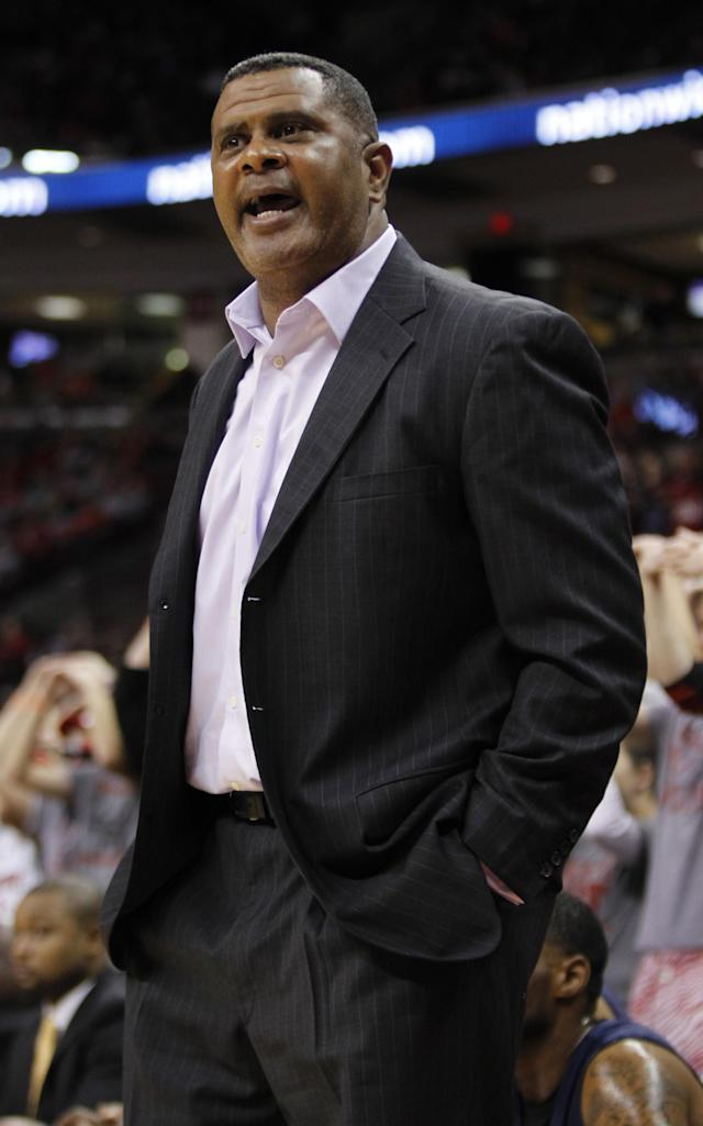Morgan State coach Todd Bozeman reacts to a call during the first half of an NCAA college basketball game against Ohio State in Columbus, Ohio, Saturday, Nov. 9, 2013. Ohio State won 89-50. (AP Photo/Paul Vernon)