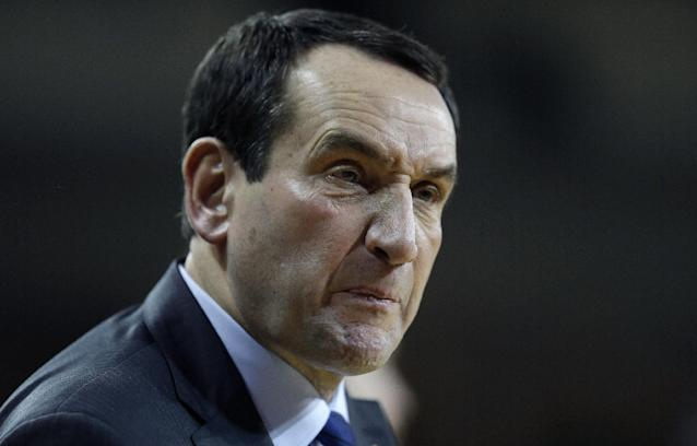 Duke head coach Mike Krzyzewski glares at a referee during the second half of their NCAA college basketball game against Boston College on the Boston College campus in Boston, Saturday, Feb. 8, 2014. Duke defeated Boston College 89-68. (AP Photo/Stephan Savoia)