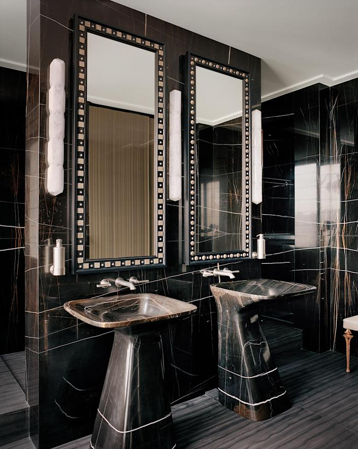 Richly figured stone, sculptural forms, and gleaming metal make for next-level luxury. Shown is a Paris bath by Jacques Grange.