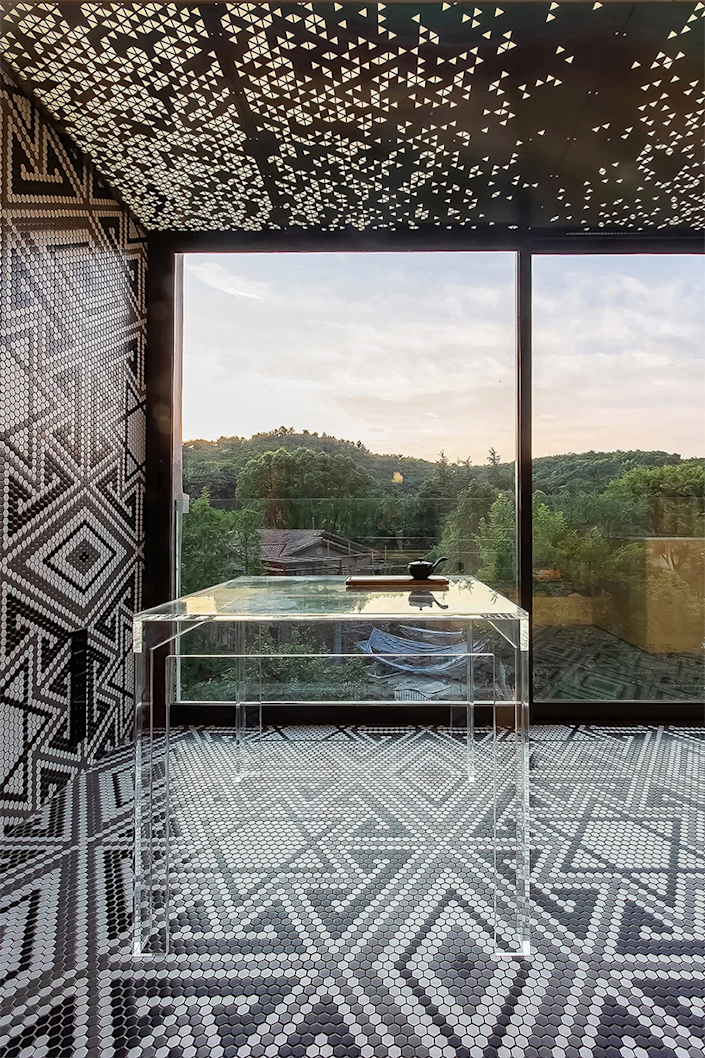 Bold black and white tile mosaic lines the spacious lookout area inside the Live and Fun apartment.