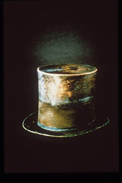 """FILE - This undated file photo originally released by the Smithsonian, the top hat President Abraham Lincoln wore the night he was assassinated, is shown. Lincoln's famous top hat, now brown and glossy with age, is currently on display at the Smithsonian's National Museum of American History in the """"Changing America: The Emancipation Proclamation, 1863 and the March on Washington, 1963"""" exhibit. It's one of a number of Lincoln artifacts that history buffs can find in the Smithsonian collection in Washington D.C. (AP Photo/Smithsonan, file)"""