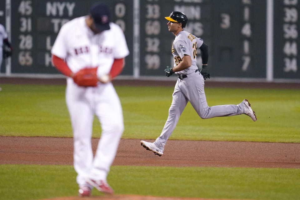 Oakland Athletics' Matt Olson, right, rounds the bases on his solo home run off Boston Red Sox starting pitcher Eduardo Rodriguez during the sixth inning of a baseball game, Wednesday, May 12, 2021, in Boston. (AP Photo/Charles Krupa)