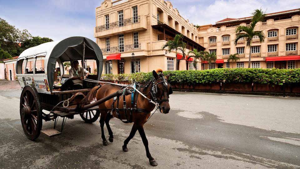 2012 Manila Philippines. Intramuros is the oldest district and h, How Much to Tip When Traveling to These 25 Countries, MANILA, PHILIPPINE -MAY2:A horse drawn carriage the most popular forms o