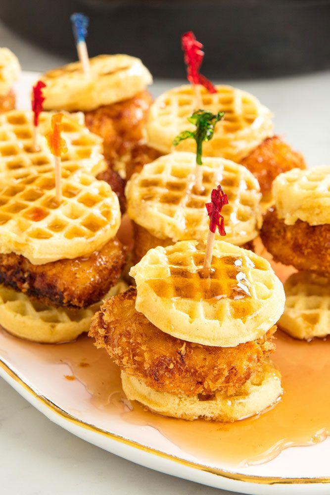 """<p>Put these on your party spread and watch them disappear. </p><p>Get the recipe from <a href=""""https://www.delish.com/cooking/recipe-ideas/recipes/a48596/chicken-waffles-sliders-recipe/"""" rel=""""nofollow noopener"""" target=""""_blank"""" data-ylk=""""slk:Delish"""" class=""""link rapid-noclick-resp"""">Delish</a>.</p>"""
