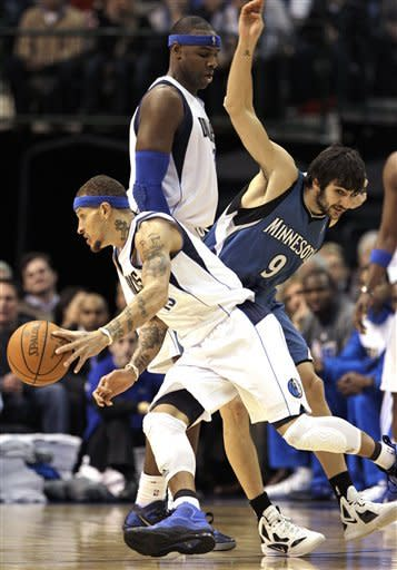 Dallas Mavericks' Delonte West drives around Minnesota Timberwolves' Ricky Rubio (9), of Spain, with help on a pick by Mavericks' Brendan Haywood in the first half of an NBA basketball game, Wednesday, Jan. 25, 2012, in Dallas. (AP Photo/Tony Gutierrez)