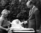 """<p>Queen Elizabeth II gave birth to her third child, <a href=""""https://www.townandcountrymag.com/society/tradition/a12838338/prince-andrew-facts/"""" rel=""""nofollow noopener"""" target=""""_blank"""" data-ylk=""""slk:Prince Andrew"""" class=""""link rapid-noclick-resp"""">Prince Andrew</a>, at Buckingham Palace on February 19, 1960.</p><p><em>Above</em>: Prince Philip and Princess Anne hold Prince Andrew's hands as he sits up in his pram on September 7, 1960.</p>"""