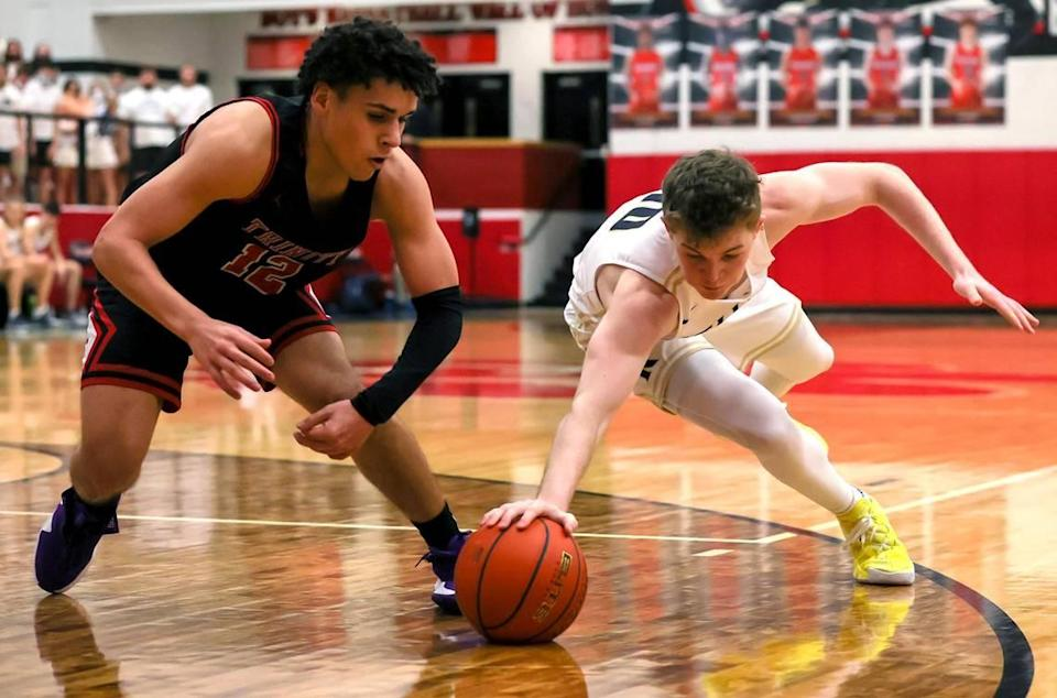 Keller guard Blake Bahr (10) and Trinity guard Jeremy Matos (12) go for a loose ball during the first half of a 6A Bi-District High School Basketball playoff game played Monday, February 22, 2021 at Colleyville Heritage High School. (Steve Nurenberg Special to the Star-Telegram)